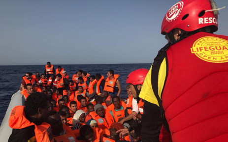 FILE: Spanish Proactiva Open Arms charity personnel rescue migrants off Libya. Picture: @proactivaservice/Facebook.com.