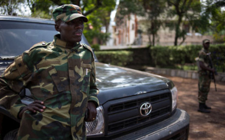 The head of the M23 rebel military forces, Brigadier-General Sultani Makenga leans on a car on November 25, 2012 on the grounds of a military residence in Goma. Picture: AFP.
