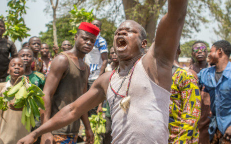 A man gestures as protesters erect makeshift barricades with tires and branches during a demonstration against Benin President Patrice Talon in Toui, an opposition stronghold, on 7 April 2021. Picture:  Yanick Folly/AFP
