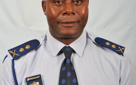 A forensic investigator at the scene where a senior Johannesburg policeman's body was found outside Hammanskraal near Pretoria on 18 June 2013. Picture: Barry Bateman/EWN.
