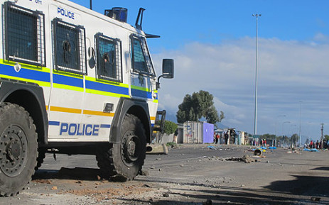 Police keep an eye on Nyanga residents during a protest. Picture: Nathan Adams/EWN