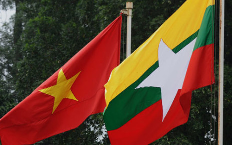 The Myanmar national flag flies next to the Vietnamese national flag. Picture: AFP.
