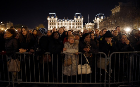 People gather outside Notre Dame cathedral in Paris on 15 November 2015 during mass in homage victims two days after a series of deadly attacks. Picture: AFP