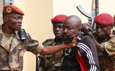 """In this file photo taken on 29 October, 2018 members of the armed forces arrest Central African Republic MP Alfred Yekatom aka """"Rambo"""" (C), who represents the southern M'baiki district former militia leader, after he fired the gun at the parliament in Bangui. Yekatom was extradited on 17 November 2018 to The Hague, The Netherlands, after an arrest warrant was issued by the International Criminal Court. Picture: AFP"""