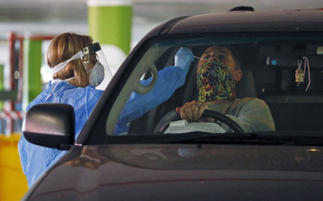 FILE: A Dis-Chem Pharmacy health professional collects a nasal swab for a COVID-19 coronavirus test at a drive-through testing site at a mall in Centurion on 9 April 2020. Picture: AFP