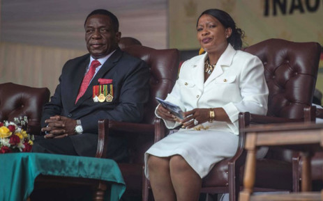 Zimbabwean newly sworn-in President Emmerson Mnangagwa and his wife Auxilia sit during the Inauguration ceremony at the National Sport Stadium in Harare, on November 24, 2017. Picture: AFP.