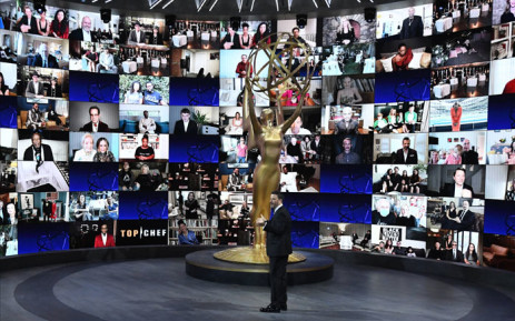 This handout picture released courtesy of Image Group LA/ American Broadcasting Companies, Inc./ ABC shows shows host Jimmy Kimmel in front of a wall of nominees watching remotely at the Staples Center during the 72nd Primetime Emmy Awards ceremony held virtually on 20 September 2020. Picture: AFP