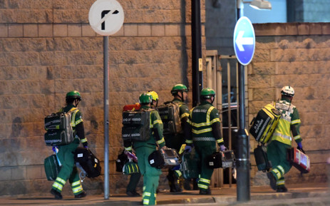 Medics deploy at the scene of an explosion during a concert in Manchester, England on 23 May, 2017. Picture: AFP.