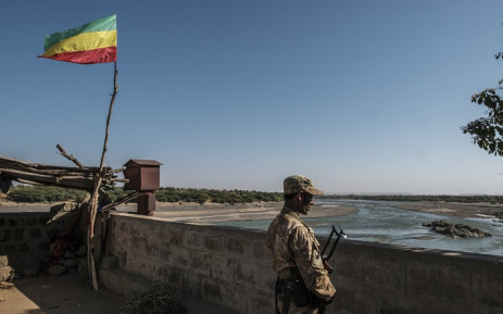 In this file photo, a member of the Amhara Special Forces watches on at the border crossing with Eritrea where an Imperial Ethiopian flag waves, in Humera, Ethiopia, on November 22, 2020.  Picture: AFP
