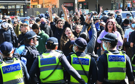 Anti-lockdown protesters chant slogans at Melbourne's Queen Victoria Market during a rally on 13 September 2020, amid the ongoing COVID-19 coronavirus pandemic. Melbourne continues to enforce strict lockdown measures to battle a second wave of the coronavirus. Picture: AFP.