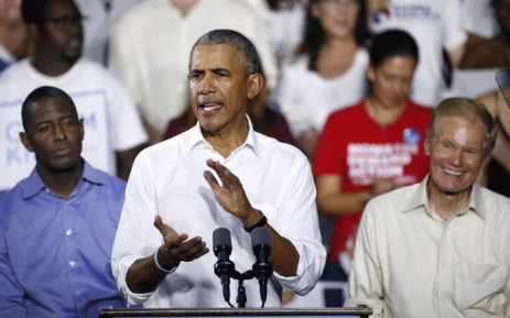 Florida Democratic gubernatorial nominee Andrew Gillum, and Senator Bill Nelson listen to former President Barack Obama as he addresses the media and supporters as they stump for votes at a rally in Miami, Florida 2 November, 2018. Picture: AFP.
