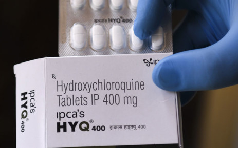 In this file photo taken on April 26, 2020 a vendor shows hydroxychloroquine (HCQ) tablets at a pharmacy in Amritsar, India. Picture: AFP