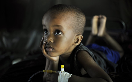 FILE: Mohammed, suffering from Malaria, recovers at a clinic. Picture: United Nations Photo.