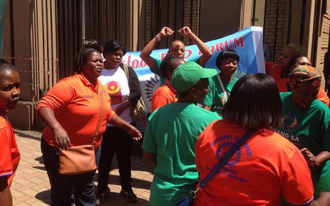 Members of the Diepsloot Early Childhood Development Forum sing outside court after sentencing was handed on 29 October 2014. Picture: Reinart Toerien/EWN.