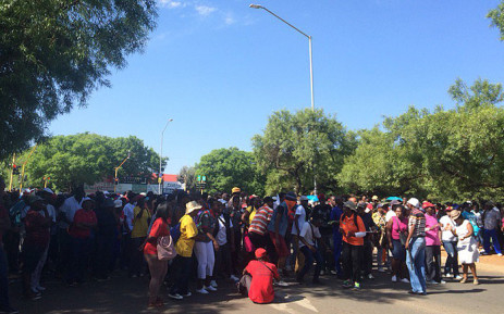 Members of the EFF student command attempted to prevent students from entering the TUT Pretoria west campus, but they pushed through with the help of the police. Picture: Barry Bateman/EWN.