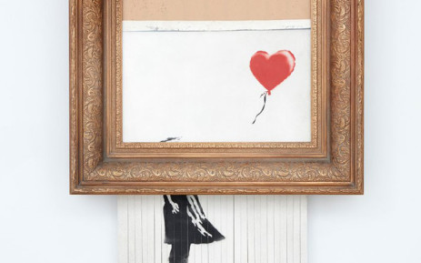 The shredded Banksy painting. Picture: @Sothebys/Twitter