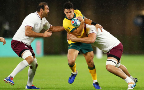 Australia's Matt Toomua takes on two Georgia players during their Rugby World Cup match in Shizuoka, Japan on 11 October 2019. Picture: @rugbyworldcup/Twitter