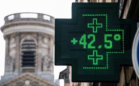 A picture taken on 25 July 2019 shows a pharmacy thermometer displaying a temperature of 42.5 degrees Celsius, in Paris, as a new heatwave hits the French capital. Picture: AFP