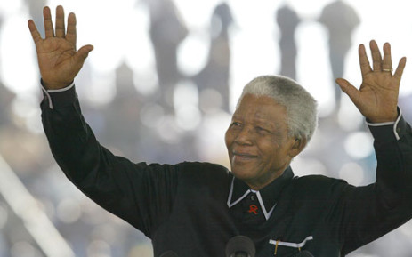 FILE: Former South African President Nelson Mandela pays tribute to his life-long friend and ANC colleague Walter Sisulu, at the apartheid struggle hero's funeral in Soweto 17 May 2003. Picture: AFP.