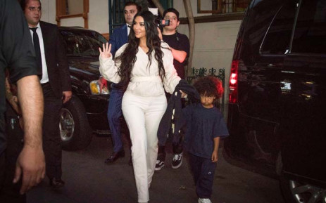 US reality television star Kim Kardashian waves her hand as she walks with her son Saint in Yerevan on 7 October 2019. The US reality television star Kim Kardashian baptised her children during a visit to her ancestral homeland Armenia