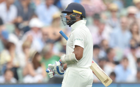 India opener Murali Vijay walks off the ground after being dismissed during day three of the first Test cricket match against Australia at the Adelaide Oval on 8 December 2018. Picture: AFP
