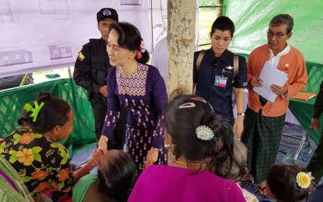 Myanmar State Counselor Aung San Suu Kyi (centre L) meets with Myo ethnic people in northern Maungdaw, Myanmar's Rakhine State on November 2, 2017. Picture: AFP