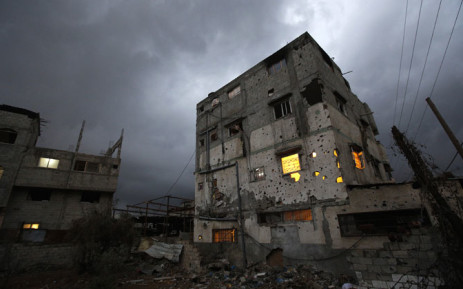 A destroyed Palestinian house on a rainy day in Al-Shejaeiya neighbourhood in the east of Gaza City, 19 October 2014. Picture: EPA.