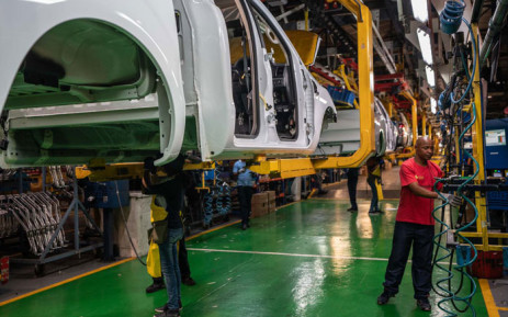 Workers assemble a vehicle at Ford's Silverton assembly plant. Picture: @FordSouthAfrica/Twitter