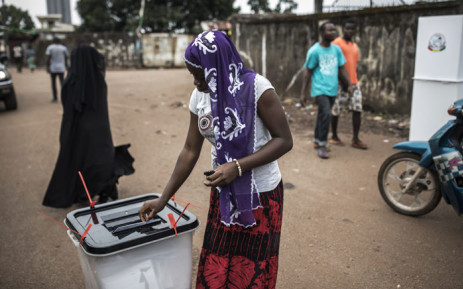 FILE: A voter casts her ballot at a voting booth in the popular opposition neighbourhood of Bambeto during presidential elections in Conakry, Guinea on 18 October 2020. Picture: AFP
