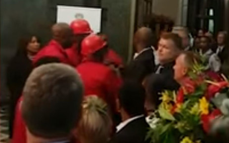 A screengrab of EFF MPs confronting Parliament security staff after President Cyril Ramaphosa's State of the Nation Address on 7 February 2019.