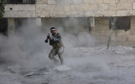 FILE: An opposition fighter firing a rocket propelled grenade during clashes in the Salaheddin district of the northern Syrian city of Aleppo. Picture:AFP