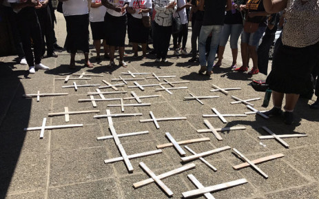 FILE: Families and supporters of 37 psychiatric patients who died after being transferred from Life Healthcare Esidimeni gather around white handmade crosses during a march at the Gauteng Health MEC's offices. Picture: Masego Rahlaga/EWN.