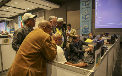 ANC Western Cape election head Ebrahim Rasool and other members of the party monitor results at the IEC Results Centre in Cape Town. Picture: Cindy Archillies/EWN