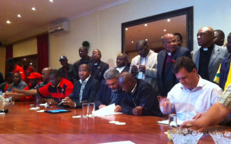 Lonmin officials and union members signing a wage agreement reached on 18 September 2012. Picture: Gia Nicolaides/EWN.