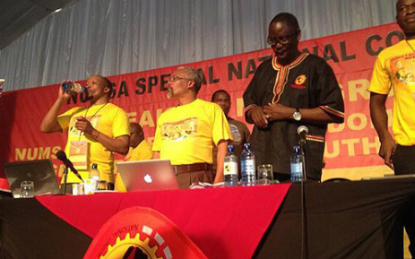 Numsa leadership (with Andrew Chirwa at far right) with suspended Cosatu Secretary General Zwelinzima Vavi (second from right) at the union's special congress, 18 December 2013. Picture: Govan Whittles/EWN