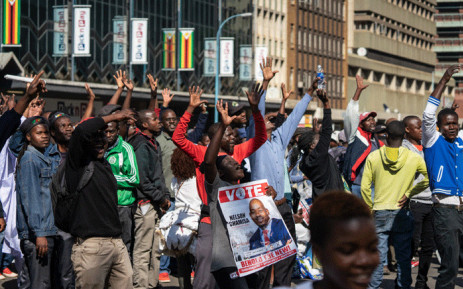 Protesters hold a poster of opposition Movement for Democratic Change (MDC) leader Nelson Chamisa during a protest at Unity Square in Harare on 16 August 2019. Picture: AFP