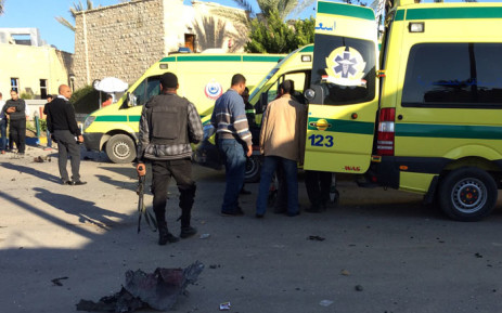 FILE: Emergency personnel and security forces stand next to ambulances outside the Swiss Inn hotel in the Egyptian town of El-Arish, in the Sinai peninsula, following an attack on the hotel by two suicide bombers and a gunman. Picture: AFP