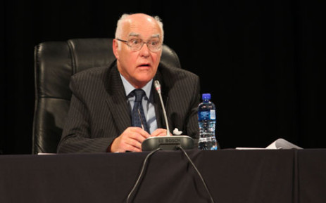 Ian Farlam listens to comments made on day one of the Farlam Commission into the Marikana shooting. Picture: Taurai Maduna/EWN
