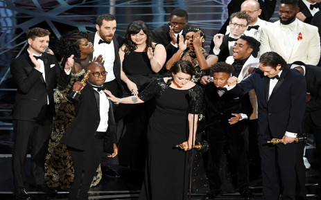 FILE: Producer Adele Romanski (C), writer/director Barry Jenkins, producer Jeremy Kleiner and cast/crew members accept Best Picture for 'Moonlight'. Picture: Getty Images/AFP.