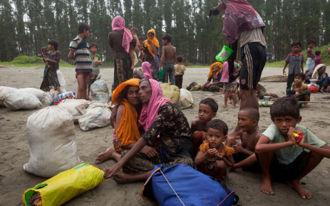 FILE: This undated photo shows newly arrived Rohingya refugees sit at Shamlapur beach in Cox's Bazar district, Bangladesh, after travelling for five hours in a boat across the open waters of the Bay of Bengal. Picture: Unicef