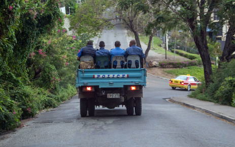 FILE: Police commute on a road as the close streets leading to Parliament house in Port Moresby on 28 May 2019.  Picture: AFP