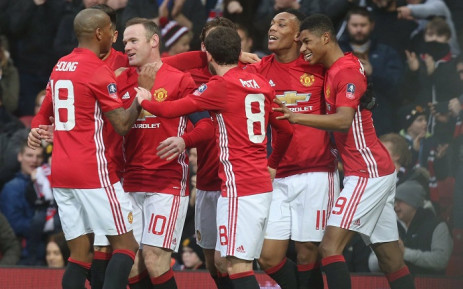 Manchester United striker Wayne Rooney celebrated by his team mates. Picture: Twitter @ManUtd.