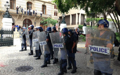 Police fired stun grenades outside Parliament on 11 November 2015 to disperse striking Parliamentary staff affiliated to Nehawu. Picture: Rahima Essop/EWN.