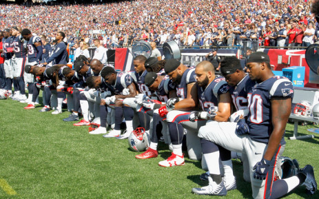 FILE: Members of the New England Patriots kneel during the US national anthem before a game against the Houston Texans at Gillette Stadium on 24 September 2017 in Foxboro, Massachusetts. Picture: AFP.