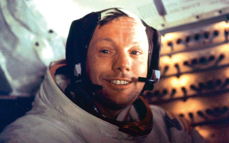 """Apollo 11 space mission US astronaut Neil Armstrong is seen smiling at the camera aboard the lunar module """"Eagle"""" on July 21, 1969 after spending more than 2 hours on the lunar surface. Picture: NASA/AFP."""