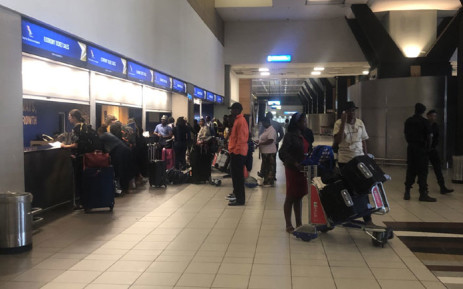 Passengers hoping to make alternative travel arrangements at the SAA counters at OR Tambo International Airport on 15 November 2019 after finding their flights cancelled by a strike. Picture: Sifiso Zulu/EWN
