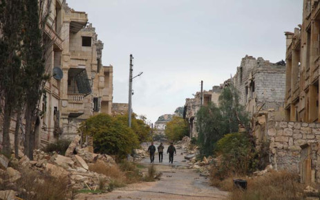 FILE: Syrian rebel-fighters from the National Liberation Front (NLF) patrol an area near the frontline in the rebel-held al-Rashidin district of western Aleppo's countryside near Idlib province, on 26 November 2018. Picture: AFP