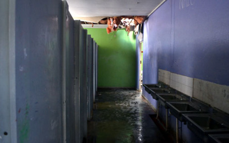 A bathroom at Cascade Primary School where intruders caused flooding after entering through the ceiling. Picture: Aletta Gardner/EWN