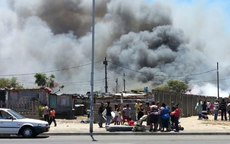 Valhalla Park homes ablaze, 23 December 2013. Picture: Supplied.