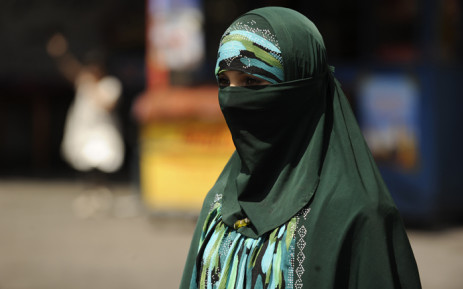 A Muslim ethnic Uighur woman walks on a street in Urumqi, capital of China's Xinjiang region on 3 July 2010 ahead of the first anniversary of bloody violence that erupted between the region's Muslim ethnic Uighurs and members of China's majority Han ethnicity. Picture: AFP.
